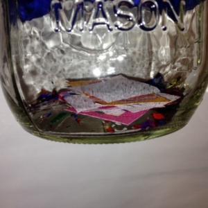 confetti in the bottom of the mason jar