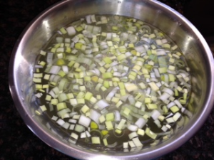 leeks in a bowl of lukewarm water.
