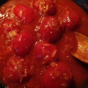 whole tomatoes added to the onion mixture